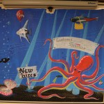 Angel fish detail, balloon detail and text, tetra detail and messenger bag, banner text touch up, diver, and submarine